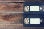 Stack of VHS video tape cassette over wooden background. top view photo. retro style image — Stock Photo