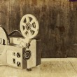Old 8mm Film Projector over wooden table and textured background — Stock Photo #76313841