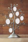 Image of vintage antique classical frame of family tree on wooden table. — Stock Photo