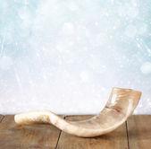 Shofar (horn) on wooden table. rosh hashanah (jewish holiday) concept . traditional holiday symbol. — Stock Photo