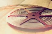 Top view image of old 8 mm movie reel over wooden background — Stock Photo