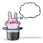Rabbit in hat trick cartoon — Vector de stock