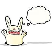 Kreslený králík v díře — Stock vektor