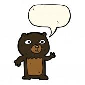 Cartoon waving black bear cub with speech bubble — Stock Vector