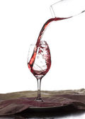 Red wine is poured into a glass — Stock Photo
