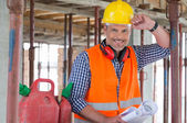 Happy Engineer With Blueprint On Site — Stock Photo