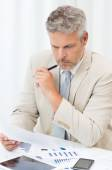 Businessman Looking At Document — Stock Photo
