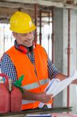 Architect Looking At Blueprint On Site — Stock Photo