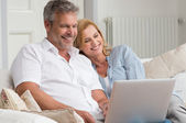 Mature Couple With Laptop — Stock Photo