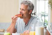 Man Eating A Jam Toast — Stock Photo