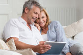 Happy Mature Couple With Tablet — Stock Photo