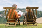 Mature Couple Reading Book — Stock Photo