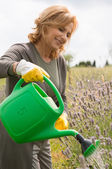 Happy Woman Watering Plants — Stock Photo