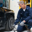 Mechanic Checking Tyre Pressure — Stock Photo #57385321