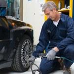 Mechanic Checking Tyre Pressure — Stock Photo #57385321
