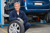 Tyre Dealer Holding A Tire — Stock Photo