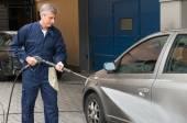 Mechanic Man Washing A Car — Stock Photo