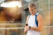 Male Athlete Looking At Watch — Stock Photo