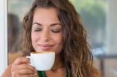 Carefree Woman Drinking Capuccino — Stock Photo