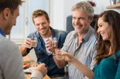 Toasting with wine glasses — Stock Photo