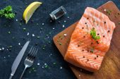 Fresh salmon fillet with pepper — Stock Photo