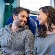 Happy couple smiling in train — Stock Photo #70584349