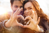 Couple with heart and love symbol — Stock Photo