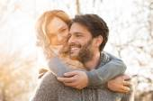 Happy couple piggyback — Stock Photo