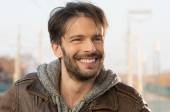Handsome and happy man outdoor — Stock Photo