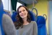 Happy smiling woman in train — Stock Photo