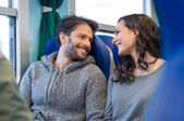 Happy couple smiling in train — Stock Photo