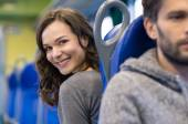 Happy passengers in train — Stock Photo
