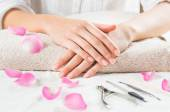 Beautyful woman  hands on  towel — Stock Photo