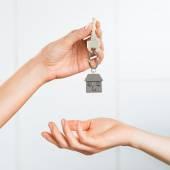 Woman receiving house key — Stock Photo
