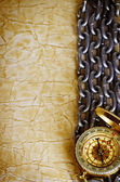 Compass, anchor and  chain on vintage old paper background — Stock Photo