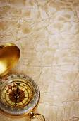 Compass on vintage old paper background — Stock Photo