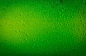 Texture water drops on the bottle of beer. Beer background — Stock Photo