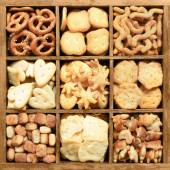 Assorted party cookies in wooden box — Stock Photo