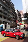 Taxi and unidentified people near Mong Kok metro station — Stock Photo