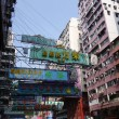 Постер, плакат: Street view with traffic and shops in Hong Kong China