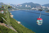 Tourists travel in cable car in the ocean park, Hong Kong — Stock Photo
