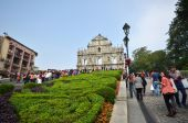 Tourists visit the ruined church of St Paul in Macau, China — Stock Photo