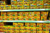 Shelves filled with instant noodle from Maggi — Stock Photo