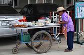 An street vendor prepares food at street — Stock Photo