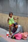 Beggars beg for money on the street — Stock Photo