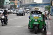 "Traditional street taxi ""tuk-tuk"" on a street — Stockfoto"