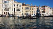 Tourists travel on gondolas at canal in Venice, Italy — Stock Photo