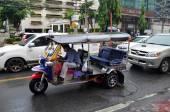 Tuk-tuk moto taxi on the street in the Chinatown area in Bangkok — Stock Photo
