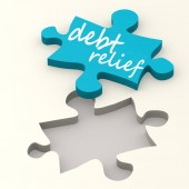 Debt relief on blue puzzle — Stock Photo