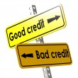 Good and bad credit with yellow road sign — Stock Photo #79129974
